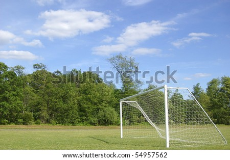 An empty soccer net on a bright day - stock photo