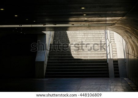 An empty stairs raise up from the subway