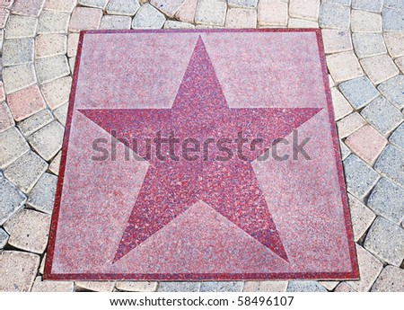 An empty star from the Walk of Stars in Palm Springs, California. - stock photo