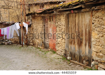 an empty street in a village - stock photo