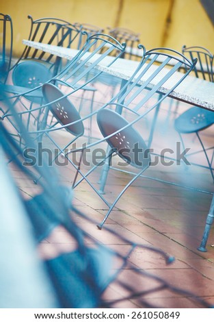 An empty table and chairs in a small cafe - stock photo