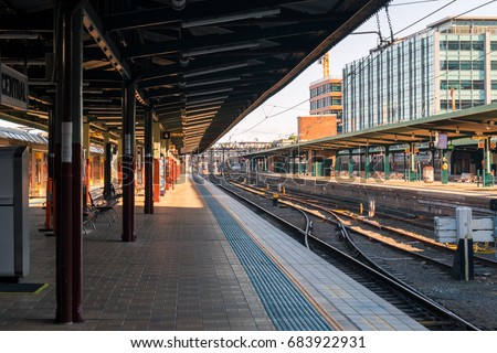 An empty train station platform and empty railway at Sydney Central station