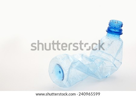 An empty twisted plastic bottle - stock photo