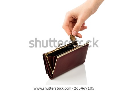 an empty wallet and a hand which holds a coin in front of white background - stock photo