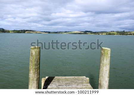 An empty wharf pier on a calm lake in New Zealand. - stock photo
