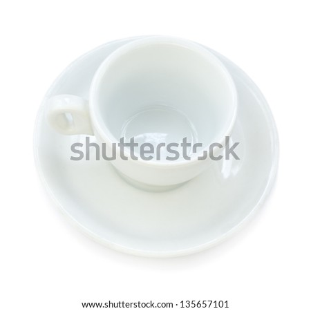 An empty white ceramic coffee cup and matching plate from above, isolated on white background.