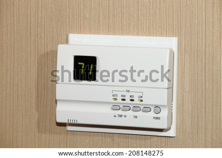 An energy saving digital thermostat - stock photo
