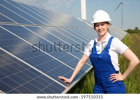An engineer posing with solar energy panels - stock photo