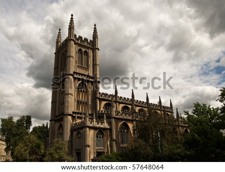 An english church with cloudy sky above - stock photo