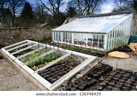 An English Country Garden Greenhouse and Allotment - stock photo