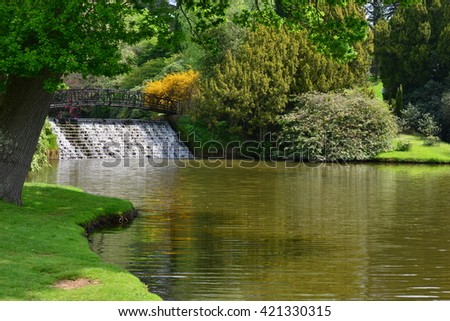 An English country garden in late springtime with a waterfall,