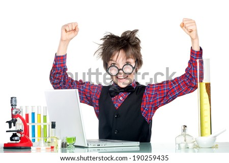 An enthusiastic boy working at laptop in the school scientific project - stock photo