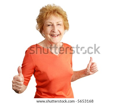 An enthusiastic red haired senior lady giving two thumbs up.  Isolated on white. - stock photo