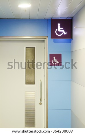 An entrance to the toilet for the disabled - stock photo
