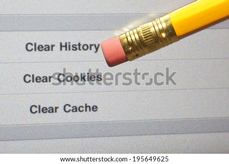An eraser pointing to a clear internet history options on a computer screen. - stock photo