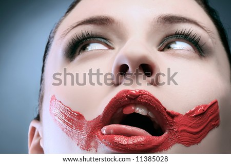 an erotic portrait of a lady with paint on face - stock photo