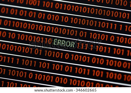 An Error text on the screen. The word is in green and the ones and zeros in red. Image taken in a small angle. - stock photo