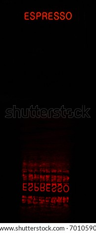 An espresso neon sign reflected in a puddle of water on a rainy night - stock photo