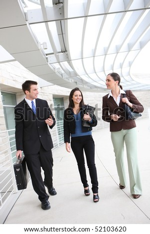 An ethnic  man and woman business team at office building - stock photo