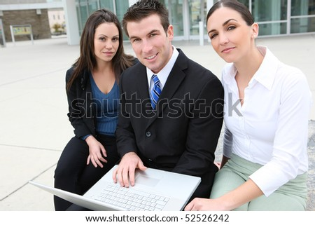 An ethnic  man and woman business team at office building on laptop computer