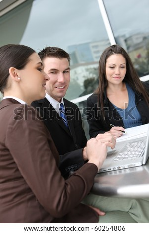 An ethnic  man and woman business team at office building on laptop computer - stock photo