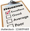 An evaluation report card on an easel with a checkmark next to the word Excellent along with other choices - good, average and poor. - stock photo