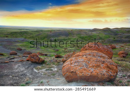 An evening at Red Rock Coulee.  The most striking features of this landscape are the round reddish, prehistoric boulders. These are sandstone concretions and  they are among the largest in the world.  - stock photo