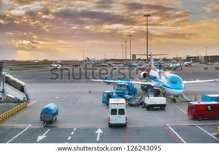 An evening photo of an airport - stock photo