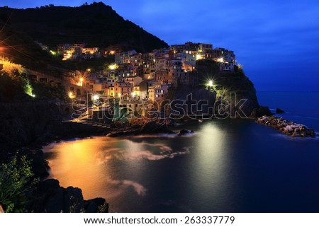 An evening view of Manarola on cliff -- an amazing village in Cinque Terre, Italy - stock photo