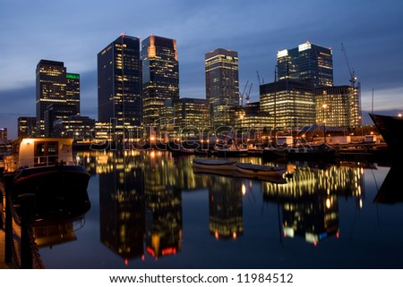 an evening view of the sky scrapers around London's docklands area of Canary Wharf - stock photo