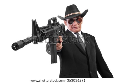 An evil gangster shooting with firearm in his hand, low angle closeup portrait, isolated on white background - stock photo