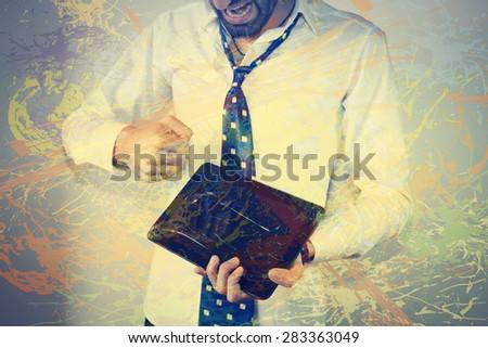 an evil man breaks tablet - stock photo