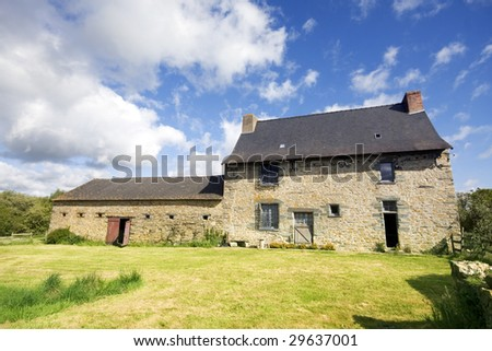 An example of a 16th century French stone house in Northern France. Property release can be made available if required. - stock photo
