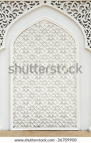 An example of Islamic design cast in concrete on a building in Terengganu, Malaysia. - stock photo