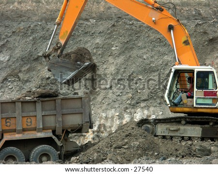 An excavator and a truck at exploration field.