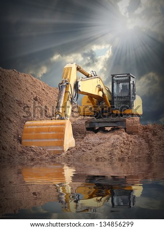 An excavator in old mine. Damaged landscape concept. - stock photo