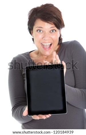 An excited brunette female showing a tablet. - stock photo