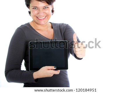 An excited brunette woman showing her tablet. - stock photo