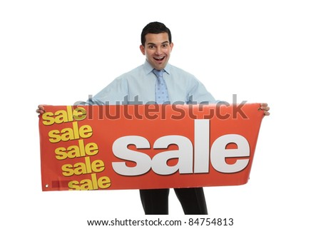 An excited man holding a sale sign ready for a retail or other type of sale.  White background. - stock photo