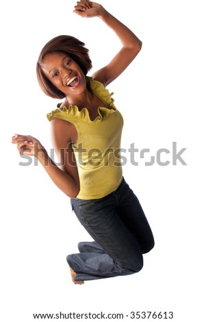 an excited woman jumps for joy - stock photo