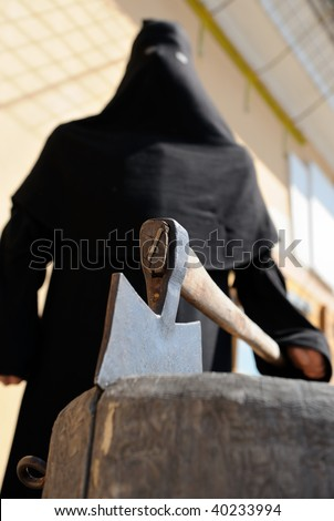 An executioner at scaffold with the axe