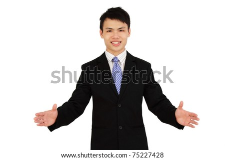 An executive with open arms smiling - stock photo