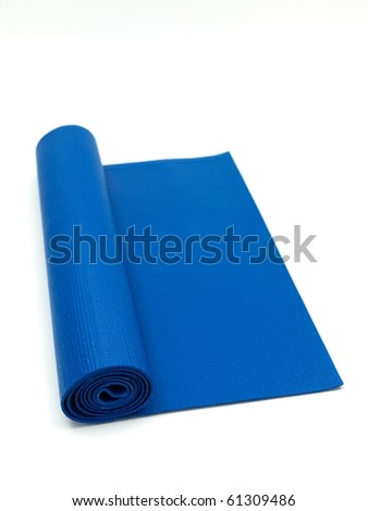 An exercise mat isolated against a white background - stock photo