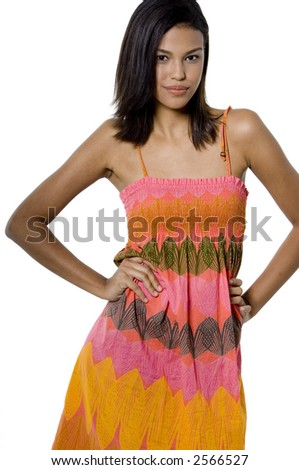 An exotic beauty wearing a summer dress on white background