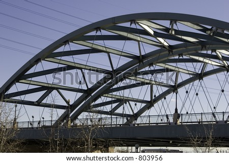 An expansiion bridge in Denver, Coloraod spans the Platte river showing the unique architecture of girders. - stock photo