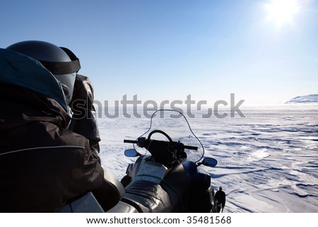 An expedition guide secures the area for polar bears.