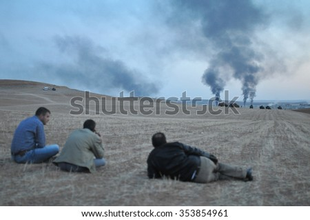 An explosion after an apparent US-led coalition airstrike on Kobane, Syria, as seen from the Turkish side of the border, near Suruc district, 29 October 2014, Sanliurfa, Turkey  - stock photo