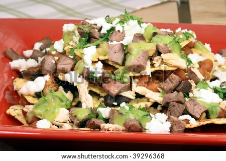 An exquisite organic mexican nachos with wheat corn tortilla and hormone free beef - stock photo