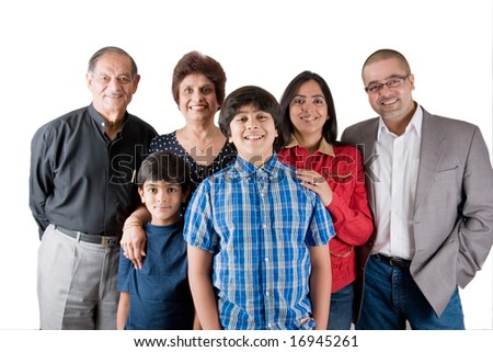 An extended Indian family all pose together in a fun setting - stock photo