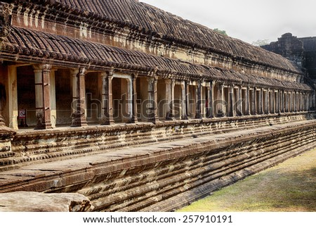 An exterior view of a stone causeway that is part of the Angkor Wat temple complex near Siem Reap Cambodia - stock photo